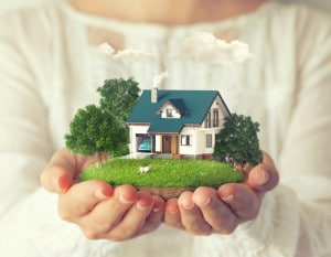 holding toy house, real estate lawyer