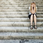 A sad girl, divorce and child custody