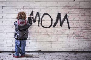 kid writing mom on wall, child support