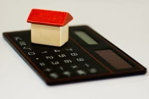 home model on a calculator, real estate