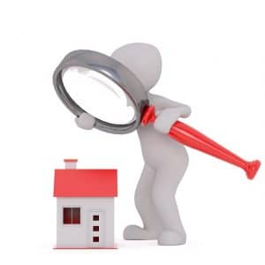 using magnifying glass to check a house, real estate
