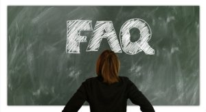 a woman facing blackboard with faq word, real estate closing attorney