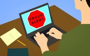 a fraud alert red sign on a computer screen